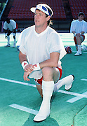 The American Football Conference Buffalo Bills quarterback Jim Kelly stretches during photo day the week before the 1989 NFL Pro Bowl football game against the National Football Conference on Jan. 24, 1989 in Honolulu. The NFC won the game 34-3. (©Paul Anthony Spinelli)