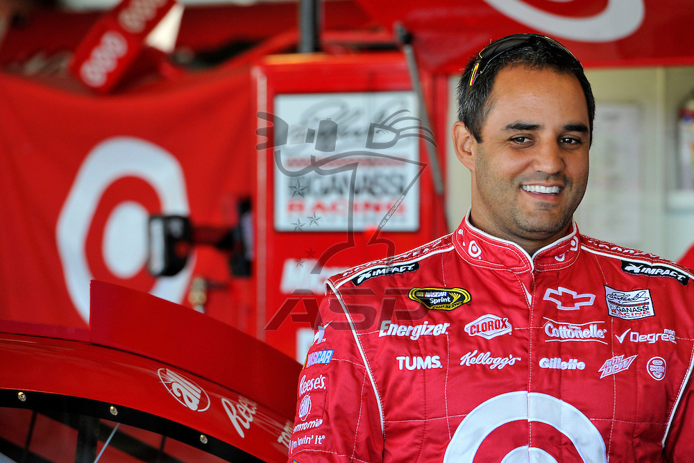 Joliet, IL - SEP 14, 2012: Juan Pablo Montoya (42) talks to crew members during practice for the Geico 400 at the Chicagoland Speedway in Joliet, IL.
