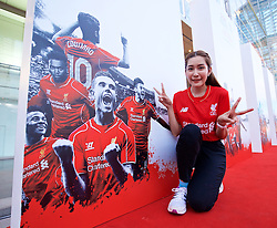 BANGKOK, THAILAND - Sunday, July 12, 2015: Liverpool supporter Yiu Chamaiporn, 27, from Bangkok, poses with LFC branding ahead of the team's arrival in Thailand for the start of the club's preseason tour. (Pic by David Rawcliffe/Propaganda)