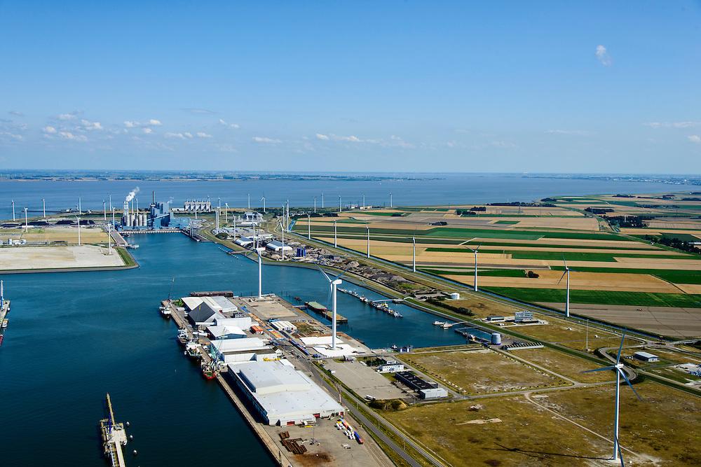 Nederland, Groningen, Eemshaven, 05-08-2014; havenbekken met windmolens, gezien naar RWE-Essen elektriciteitscentrale (kolencentrale).<br /> Harbor with RWE - Essent power plant. <br /> luchtfoto (toeslag op standard tarieven);<br /> aerial photo (additional fee required);<br /> copyright foto/photo Siebe Swart