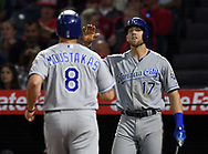 June 6, 2018 - Anaheim, CA, U.S. - ANAHEIM, CA - JUNE 06: Kansas City Royals first baseman Hunter Dozier (17) greets third baseman Mike Moustakas (8) at the plate as Mousrtakas scores on a single by Alex Gordon (4) in the fourth inning of a game against the Los Angeles Angels of Anaheim played on June 6, 2018 at Angel Stadium of Anaheim in Anaheim, CA. (Photo by John Cordes/Icon Sportswire) (Credit Image: © John Cordes/Icon SMI via ZUMA Press)