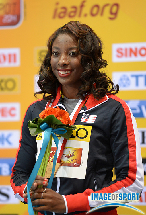 Mar 9, 2014; Sopot, Poland; Nia Ali (USA) poses with the gold medal after winning the womens 60m hurdles in the IAAF World Indoor Championships in Athletics at Ergo Arena.