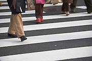 people crossing at a zebra crossing