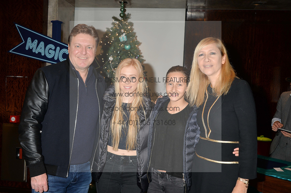 Left to right, ROD BARKER and his daughter MARISSA BARKER, FRANCESCA MOUFARRIGE and her mother TANIA BRYER at the official opening of the 2014 Tiffany & Co.Christmas Shop on Bond Street, London on 16th November 2014.