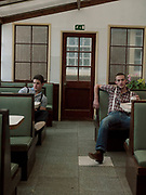 Two Teenagers Sitting In Cafe