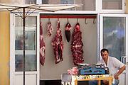 Uzbekistan, Khiva, Dekhon Bazaar. Butcher.