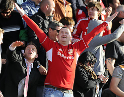 A Swindon fan celebrates - Photo mandatory by-line: Joe Meredith/JMP - Tel: Mobile: 07966 386802 04/05/2013 - SPORT - FOOTBALL - County Ground - Swindon - Swindon Town v Brentford - Npower League one Play Off
