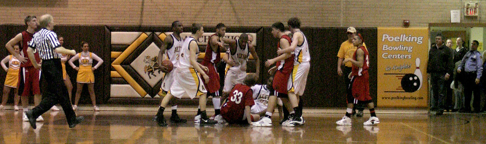 A scuffle on the floor as the LaSalle Lancers play the Alter High School Knights in varsity basketball, Friday Night, January 26, 2007, at Alter's Joe Petrocelli Gymnasium.  Though tempers were short, the incident did not escalate.