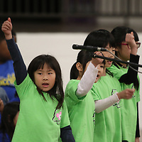 Rin Sugino, 7, raises her hand high as she performs Saturday with the North Mississippi Japanese Supplementary School at the Tupelo Cherry Blossom Festival