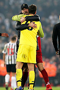 Liverpool goalkeeper Alisson Becker (13) gets the Liverpool Manager Jurgen Klopp hug during the Premier League match between Liverpool and Newcastle United at Anfield, Liverpool, England on 26 December 2018.