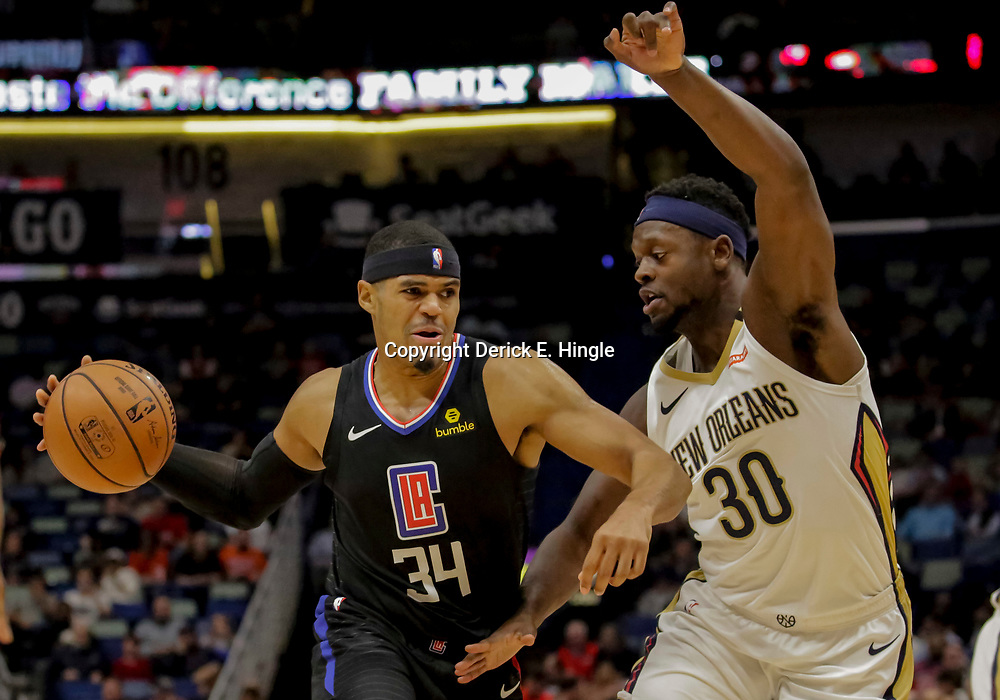 Dec 3, 2018; New Orleans, LA, USA; LA Clippers forward Tobias Harris (34) drives past New Orleans Pelicans forward Julius Randle (30) during the first quarter at the Smoothie King Center. Mandatory Credit: Derick E. Hingle-USA TODAY Sports