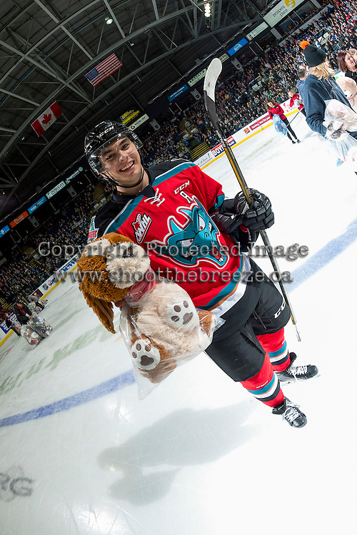 KELOWNA, CANADA - DECEMBER 3: Nick Merkley #10 of the Kelowna Rockets stands on the ice with a teddy bear after his second period goal triggered the annual toss onto the ice on December 3, 2016 at Prospera Place in Kelowna, British Columbia, Canada.  (Photo by Marissa Baecker/Shoot the Breeze)  *** Local Caption ***
