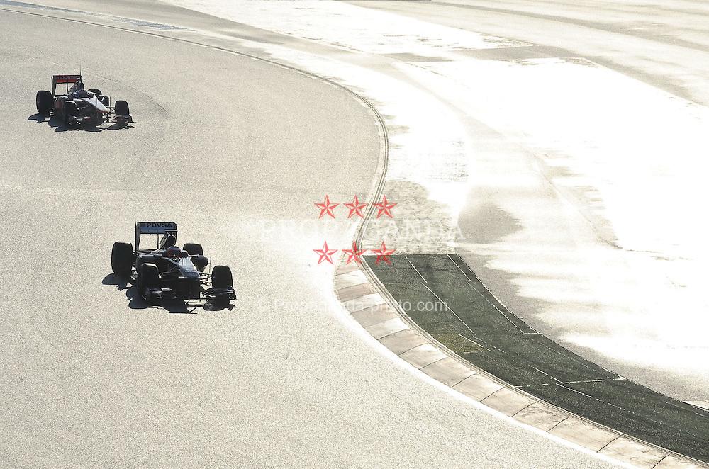 18.02.2011, Circuit de Catalunya, Barcelona, ESP, Formel 1 Test 3 2011,  im Bild Rubens Barrichello (BRA),  Williams F1 Team - Jenson Button (GBR),  McLaren F1 Team  EXPA Pictures © 2011, PhotoCredit: EXPA/ nph/  Dieter Mathis       ****** out of GER / SWE / CRO  / BEL ******