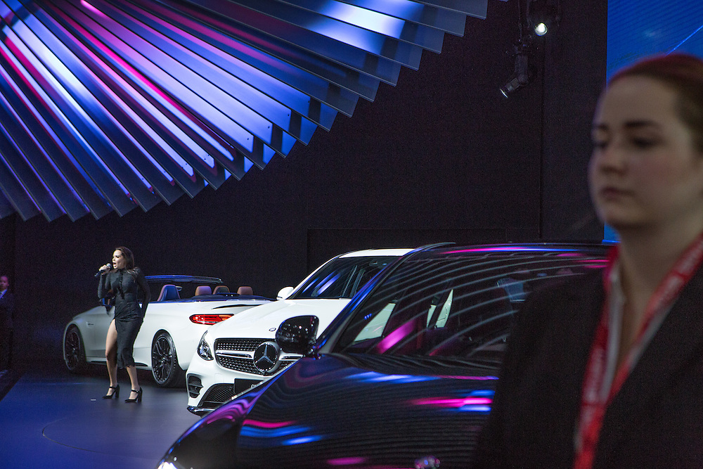 New York, NY, USA-23 March 2016. Singer Grace Capristo, left, at the introduction of three new models by Mercedes: the Mercedes-AMG E43 (right), the GLC Coupe (center) and the Mercedes-AMG C63 (left).