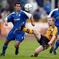 Alloa v St Johnstone..  02.11.02<br />Richard Walker clears from St Johnstone's Paul Hartley<br /><br />Pic by Graeme Hart<br />Copyright Perthshire Picture Agency<br />Tel: 01738 623350 / 07990 594431