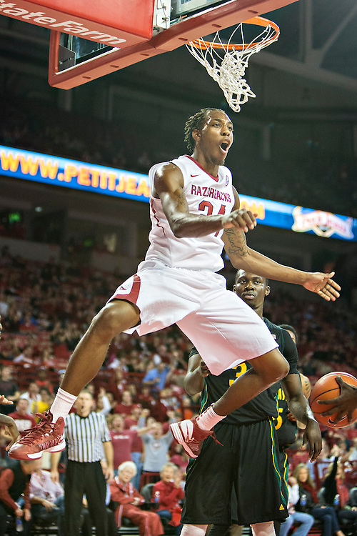 FAYETTEVILLE, AR - DECEMBER 3: Michael Qualls #24 of the Arkansas Razorbacks dunks the basketball against the SE Louisiana Lions at Bud Walton Arena on December 3, 2013 in Fayetteville, Arkansas.  The Razorbacks defeated the Lions 111-65.  (Photo by Wesley Hitt/Getty Images) *** Local Caption *** Michael Qualls