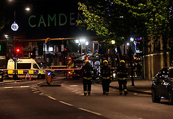 Anna Branthwaite, Camden, London<br /> 19/04/2014<br /> Fire fighters walk through Camden Market after attending to a fire that started inside the Stables at Camden Market. <br /> Photo: Anna Branthwaite/LNP