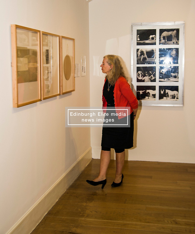 Pictured: Journalist Susan Nickalle gets up close and personal to some of Joseph Beuys less known work<br /> The Richard Demarco & Joseph Beuys A Unique Partnership exhibition examines the collaboration between the avant-garde gallerist and German post-war artist. The exhibition is open to the public between  30 July and 1 October 2016<br /> <br /> Ger Harley | EEm 28 July 2016
