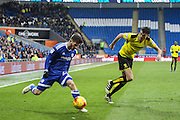 Matthew Kennedy of Cardiff City and Tom Flanagan of Burton Albion during the EFL Sky Bet Championship match between Cardiff City and Burton Albion at the Cardiff City Stadium, Cardiff, Wales on 21 January 2017. Photo by Andrew Lewis.