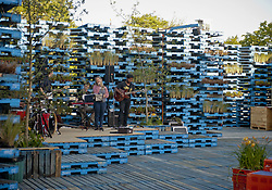 Dec. 19, 2012 - Christchurch, New Zealand - With the central cityÃ•s entertainment district still decimated from the 2010 and 2011 earthquakes, venues such as the Gap Filler Summer Pallet Pavillion have attempted to take up some of the slack. The Pallet Pavillion  contains more than 3,000 wooden pallets and is designed as a venue for creative projects, such as musical performances, set up in the empty spaces where buildings once stood. It was built by volunteers. (Credit Image: © PJ Heller/ZUMAPRESS.com)
