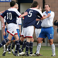 Ross County v St Johnstone.....11.03.06<br />Paul Sheerin squares up to Sean Webb after he went down down in the box winning a penalty<br />Picture by Graeme Hart.<br />Copyright Perthshire Picture Agency<br />Tel: 01738 623350  Mobile: 07990 594431
