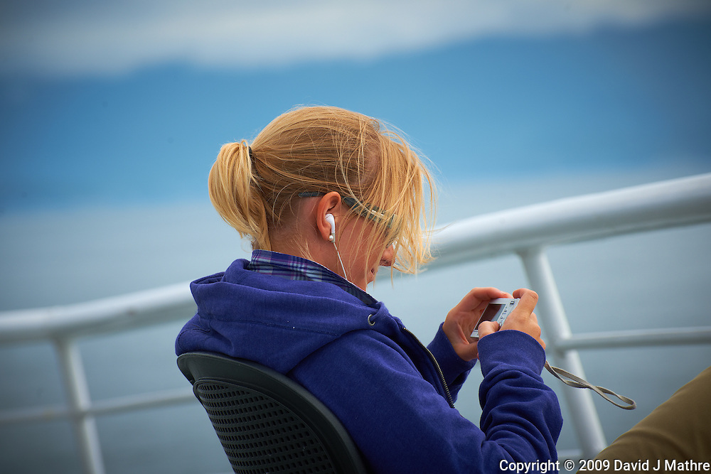 Christine Chimping on the Alaska Marine Highway. Image taken with a Nikon D3x and a 70-300 mm VR lens (ISO 100, 195 mm, f/8, 1/500 sec).