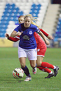 Bristol Academy's Sharla Passariello and Everton Ladies Kelly Jones during the Women's FA Cup fourth round match between Everton Ladies and Bristol Academy ladies at the Select Securities Stadium, Widnes, United Kingdom on 24 March 2015. Photo by Andrew Morfett.