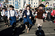 Granville Carnival, Normandy, France. Participants gather - and dance - at Rue du Port before the main procession, on the last Sunday before Lent. The carnival in Granville is the largest in Normandy, drawing some 120,000 people to this small town on the coast with a population of just 10,000, and has been running for 141 years (15 February 2015). © Rudolf Abraham