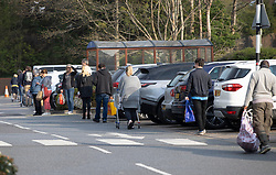© Licensed to London News Pictures. 11/04/2020. Dorking, UK. Shoppers keep their distance as they queue in the car park at a Tesco store in Leatherhead, Surrey. The government has warned that people must continue to follow the public health guidance over the Easter weekend. Photo credit: Peter Macdiarmid/LNP