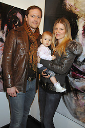 MR & MRS EMANUEL PETIT, he is the footballer and their daughter VIOLET at a private view of paintings by Lita Cabellut and Russian artist Yuri Kuper at Opera Gallery, 134 New Bond Street, London on 2nd April 2008.<br />