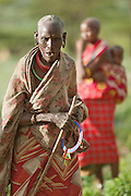Elder Samburu woman, with woman carrying child in the background.