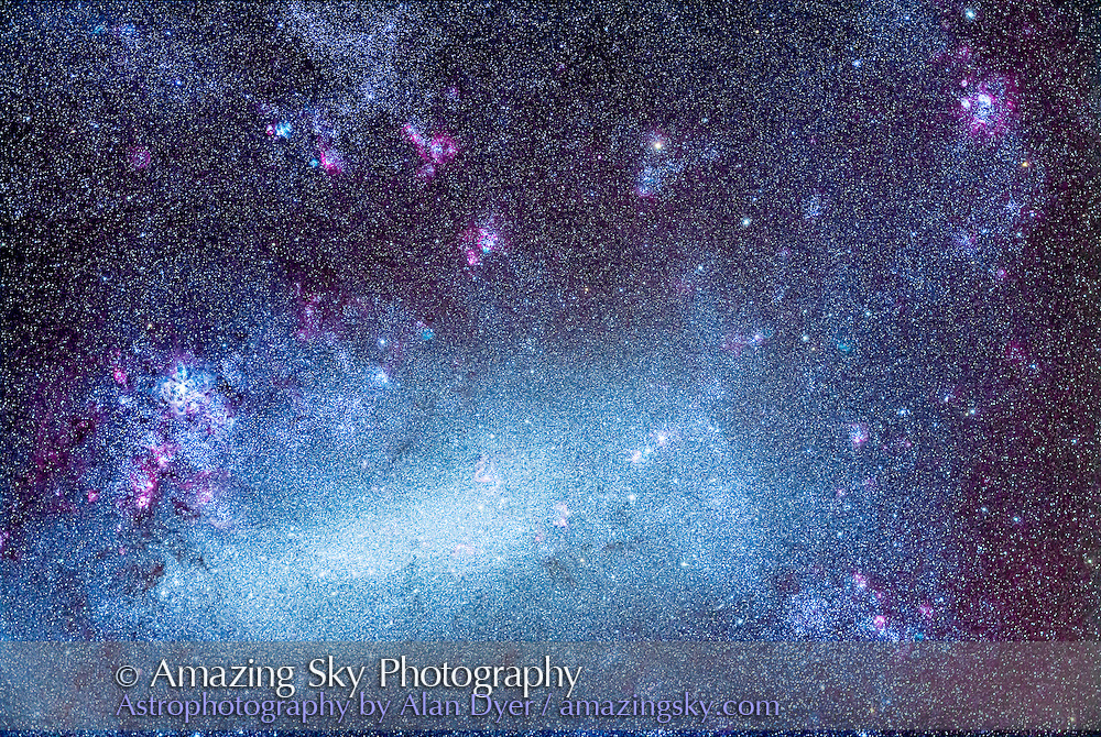 The Large Magellanic Cloud (LMC), an irregular satellite galaxy of the Milky Way, and one of the prime attractions of the southern hemisphere sky. At left is the Tarantula Nebula, NGC 2070, while at upper right is the second brightest nebula in the LMC, NGC 1763, aka the LMC Lagoon. In between are an amazing number of nebulas, both magenta and cyan in tint, as well as clusters of stars. The LMC is 160,000 light years away, and is gravitationally bound to the Milky Way, though there is some dispute whether it is orbiting the Milky Way or is passing by.<br /> <br /> This field is 6&deg; x 4&deg;, which just encompasses the majority of the LMC's structure and features. <br /> <br /> I shot this Monday, March 24, 2014 from the Warrumbungles Mountain Motel grounds, near Coonabarabran, NSW, Australia. This is a stack of 6 x 10 minute exposures with the Borg 77mm aperture astrographic lens, a 300mm f/4 system, and the Canon 5D MkII camera, filter modified by Hutech, at ISO 800. Shots had to dodge clouds moving through during the evening. Humidity was high from rain earlier in the day. But transparency was good when skies were clear.