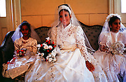 HAVANA, CUBA: A woman waits for wedding to start in a government Palacio de Matrimonios (wedding palace) in Havana, Cuba, March 2000. Cuba?s is officially a secular state and weddings are civil affairs presided over by a government attorney. They take about 15 minutes and are held in government wedding offices.   PHOTO BY  JACK KURTZ       WOMEN   CULTURE   LIFESTYLE   FAMILY
