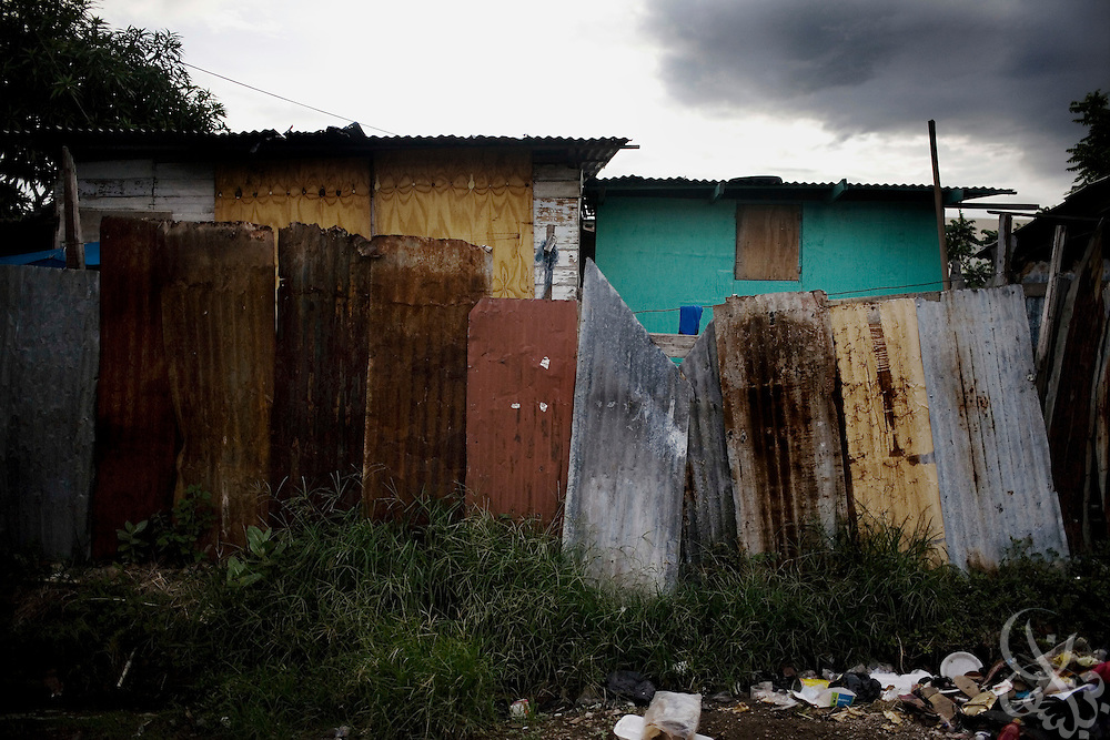 A traditional Jamaican tenement yard with a zinc fence stands in the Rema ghetto community of Kingston June 16, 2008. An estimated 30-45% of the roughly 950,000 population of Kingston live in overcrowded inner-city communities like Rema.