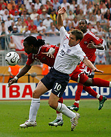 Photo: Glyn Thomas.<br />England v Trinidad & Tobago. Group B, FIFA World Cup 2006. 15/06/2006.<br /> England's Michael Owen (R) and Trinidad & Tobago's Dennis Lawrence (L).