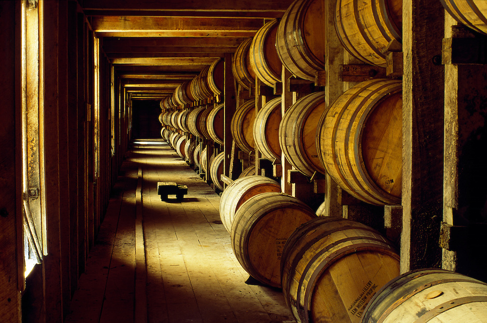 Jack Daniels whiskey whisky maturing in barrels in old store warehouse at the Lynchburg distillery, Tennessee, USA.
