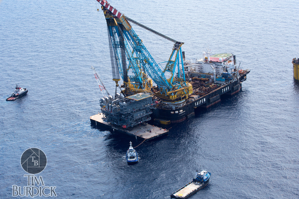 Topside module lift in the Gulf of Mexico/MISSISSIPPI CANYON by Crowley Maritime Corporation's OCEAN CLASS Tugs and the SAIPEM 7000. (Aerial Photography by Tim Burdick)
