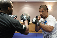 BIRMINGHAM, ENGLAND, NOVEMBER 2, 2011: Mark Munoz (right) works on his striking with Rafael Cordeiro at the media open work-out sessions inside the Hilton Hotel on November 2, 2011.