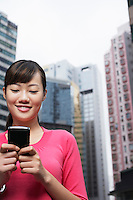 China Hong Kong woman text messaging on street