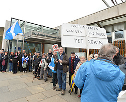 Campaign group Hands Off Our Parliament staged a rally outside the Scottish Parliament in Edinburgh today where protesters formed a symbolic protective ring around the parliament in response to what the campaigners claim is a power grab by the UK government.<br /> <br /> &copy; Dave Johnston/ EEm