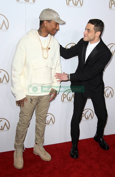 28 January 2017 - Los Angeles, California - Pharrell Williams and Rami Malek. 2017 Producers Guild Awards held at The Beverly Hilton Hotel. Photo Credit: AdMedia *** Please Use Credit from Credit Field ***