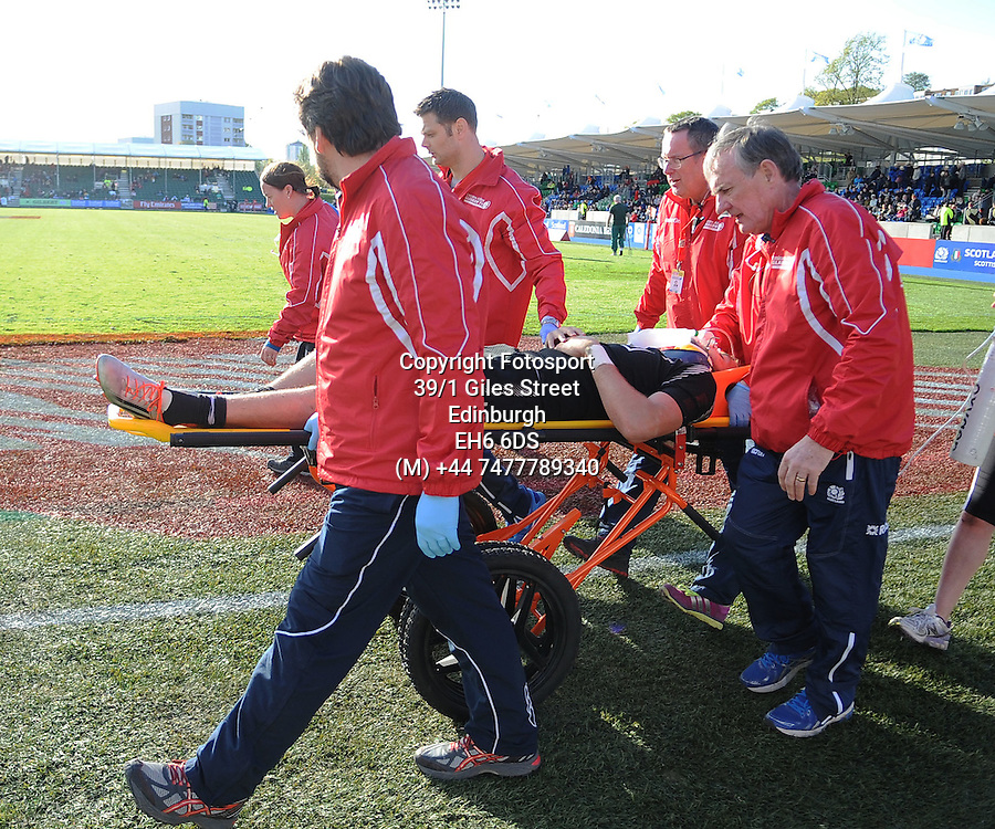 Tim Mikkelson - New Zealand is stretched off by the medics after injuring himself whilst scoring a try inthe corner.<br />