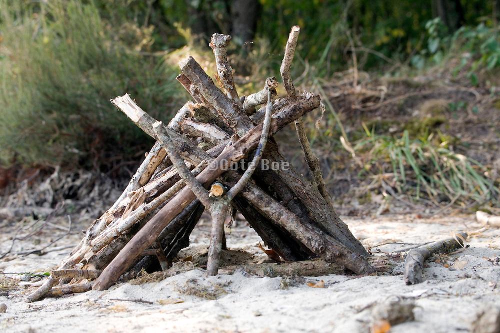 a playful little house made of wood sticks