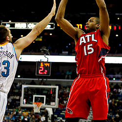 Jan 1, 2013; New Orleans, LA, USA; Atlanta Hawks center Al Horford (15) shoots over New Orleans Hornets power forward Ryan Anderson (33) during the second half of a game at the New Orleans Arena. The Hawks defeated the Hornets 95-86. Mandatory Credit: Derick E. Hingle-USA TODAY Sports