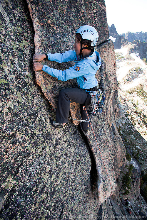Mountain Madness Climbing Guide Aili Farquhar at the North Cascades' Washington Pass climbing the South Arete of South Early Winter Spire and the Northwest Corner of North Early Winter Spire for a Helly Hansen commercial shoot.