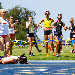 IRVINE, CA - APRIL 29: Jessica Barnard of Long Beach State falls at the end of the women's 800-meter race during the Steve Scott Invitational. (Chris Mast/Christopher Mast Images)