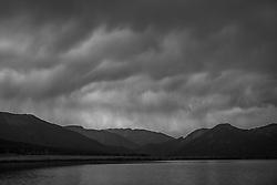 Rain clouds descend over Lake Hebgen