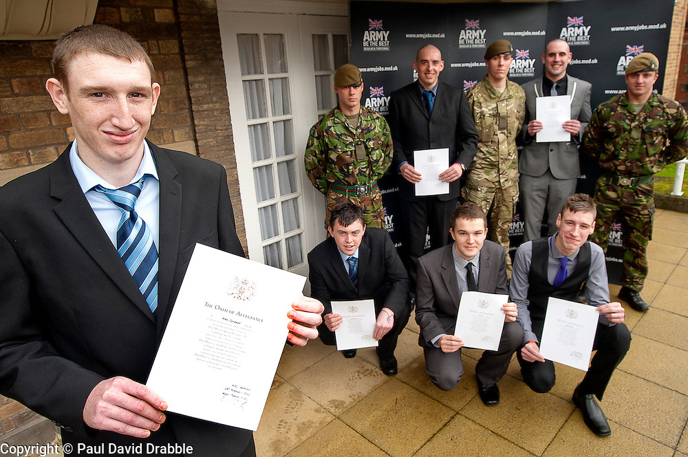 Mayor of Barnsley cllr Karen Dyson presents Oath of Allegiance certificate to Jamie Warren and (back row left to right) Rikki Cardwell, Mathew Beaumont, David Dickinson, Kane Bradbury (front Row left to right) Dale Kirk, Ashley Brown, Daniel Crossland<br /> http://www.pauldaviddrabble.co.uk<br /> 24 February 2012<br /> Image &copy; Paul David Drabble