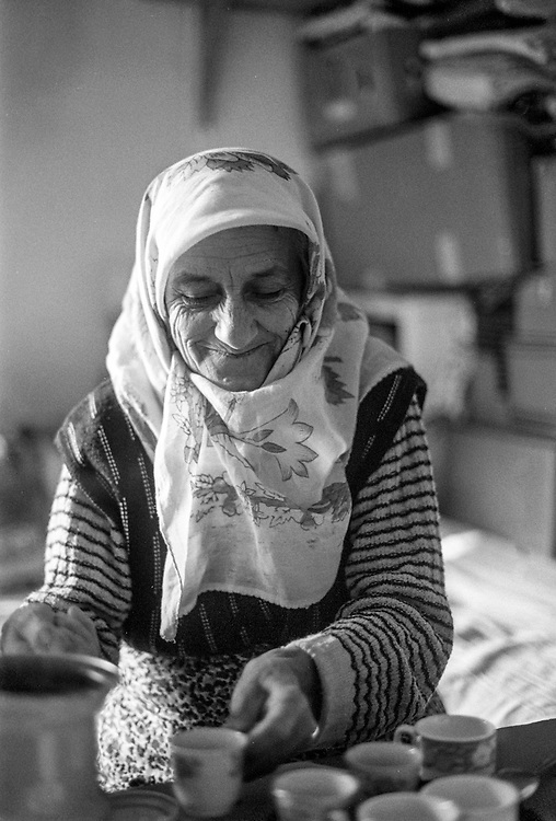 """Nana"" (Bosnian: Grandmother), a female refugee from Bosnia doing turkish coffee at the Varazdin refugee camp in Croatia in the winter of 1992."