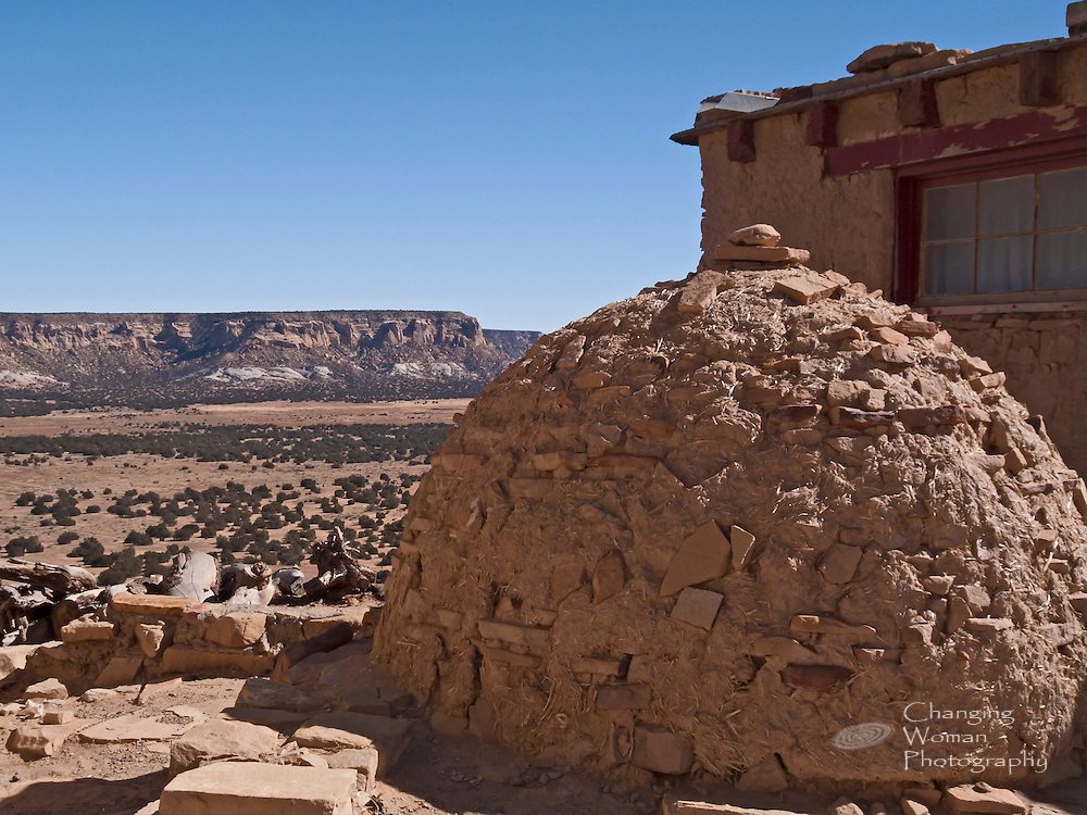 Adobe ovens like this one have long been used for baking round loaves of ovenbread, and similar structures are used for firing Acoma's famous pottery. The family that uses this oven has a great view of the inspiring landscape surrounding Sky City.